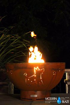 This cute fire pit features a funny cutout of a dog and paw prints. Perfect for all you dog lovers!