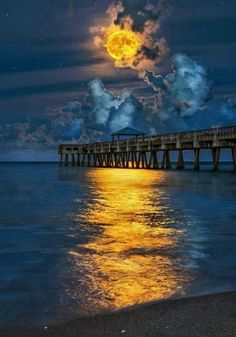 Full harvest moon over Juno beach pier. Juno Beach was one of five sectors of the Allied invasion of German occupies France in the Normandy landings on June during the Second World War. Beautiful Moon, Beautiful World, Beautiful Things, Juno Beach Pier, Palm Beach, Ciel Nocturne, Shoot The Moon, All Nature, Amazing Nature