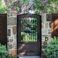 wrought iron/stone fence