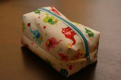 """Make a cute little makeup bag.  We made this and it is pretty small.  Finished dimensions are 5"""" long x 3"""" deep x 3"""" tall.  So made another larger one.  Cut it 9"""" x 11"""" (instead of 6"""" x 8"""")  The 12"""" zipper still is large enough.  Finished measurements of it was 7"""" long x 4"""" wide x 4"""" tall.  Might try a little larger one too.  ;)"""