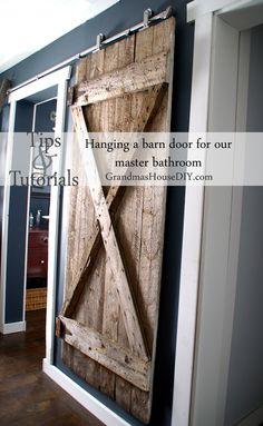 The Ultimate Pinterest Party, Week 156 | Tips and tutorial on how to install a hanging barn door on our master bathroom