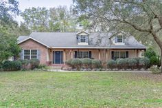 Great SE Ocala, FL home- Covered front porch welcomes you to this spacious home with wood floors, volume ceilings, split bedroom plan, and fireplace. Flex room, large dining room, large family room. 4 bedrooms, one of which is a Mother In Law suite set up. MLS#514590 Contact The McCall Real Estate Group with Keller Williams for info. 352-547-1077