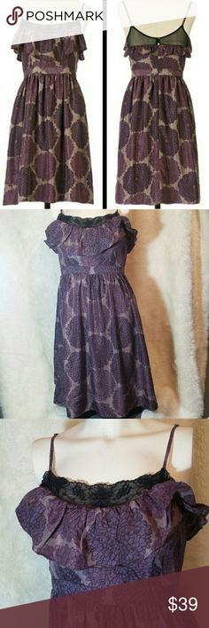 """Anthropologie Lil Silk Floral Lace Dress Size 6 Anthropologie Lil Silk Floral Lace Dress, size 6. Black oversized floral print scattered across a 100% silk purple background. Black Victorian like lace lines the top of the bust. Ruffle detailinf below the lace. Back has a zipper entry with two dainty buttons topping the closure. Fully lined with attached slip. Preowned in great condition with no rips, holes, tears or stains. Size 6. 100% silk.   Measurements  Pit to Pit 17"""" Waist 13"""" Top of…"""