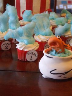 How to make these adorable Cat in the Hat cupcakes, as well as a larger, stacked cake.
