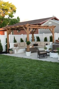 A pergola offers shade to a paver patio with custom seating in Room For Tuesday's new and improved backyard. This space is made for outdoor entertaining! Small Backyard Landscaping, Backyard Pergola, Fire Pit Backyard, Landscaping Ideas, Backyard Pools, Backyard Storage, Backyard Seating, Cozy Backyard, Small Pergola