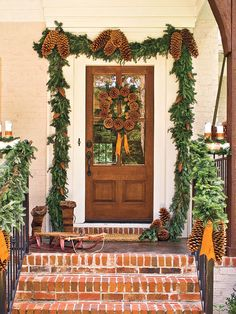 The natural beauty of the pinecones and birch logs in this arrangement adds woodland appeal to this entryway. Vintage objects, like this old wooden sleigh, enhance the rustic look.