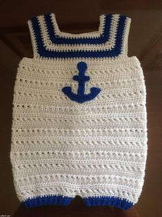 Ravelry: Navy Onesie pattern by Maru Minetto - Striped yoke onesie for babies, requires less than 80grs. of yarn, and can be made in different colors and with different embellishments to suit gender. free pdf download in English or Spanish.