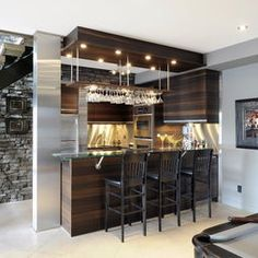 Love the stone and wood in this Industrial Chic Basement - Mosaik Design & Remodeling    (via Houzz)