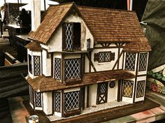 adorable dollhouse that reminds me of Helen, GA