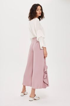 These palazzo trousers come in a cropped length with gorgeous frill detail along the sides. We're wearing ours with a blouse and mules.