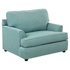 Brimming with timeless style for your den or living room, this oversized arm chair features welted detailing and turquoise cotton upholstery for a pop of col...