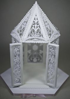 "Other Cakes - Royal icing Gazebo from ""The Art of Royal Icing"" by Eddie Spence.  Run-out panels with filigree dropped-line piping and pressure piped accents."