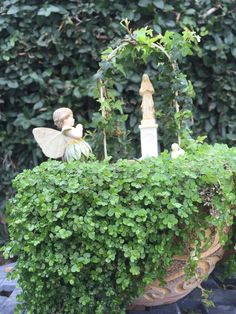 A young fairy prays with a tiny angel and the Blessed Mother. Miniature Fairy Garden