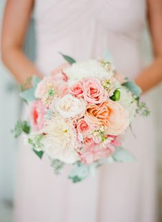 Blush pink, white, peach and pale orange blooms in a bridesmaid bouquet. Photography: Taylor Lord - www.taylorlord.com