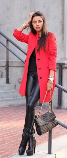 Leather leggings, bright coat, and a classic bag