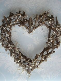 Heart wreath made of wooden twigs Decorated in bead style pearls and crystals