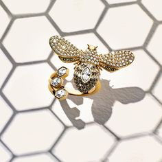 Bee mine. The Lisabel Ring's shimmering jet and clear #Swarovski crystal stripes and honeycomb detailing you can't resist are available in bio – shop now.
