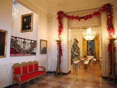 White House Christmas 2010  Festive garlands decorate the entrance to the East Room. The stairway leads to the private residence. — Image courtesy of Washington, D.C., photographer Marty Katz