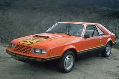 """1979 saw the debut of the new Mustang (the """"II"""" was dropped) based on the new Fox platform. A Cobra package was available which included the Turbo Charged I4. The Mustang was picked to pace the Indy 500 race for 1979, and Ford celebrated by producing about 11,000 Indy Pace Car Replicas which featured outlandish decals and functional Recaro reclining bucket seats."""