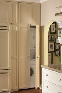 cabinets to hide washer/dryer in kitchen with storage above!