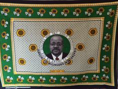 "John Magufuli was inaugurated as Tanzania's fifth, and newest president on November 5, 2015. This is the official kanga for the State House celebrating the occasion. It was produced by Nida Textiles in Dar es Salaam. The English translation for the words around the center is: Congratulations to the Honorable Dr. John P. Magufuli. The Fifth President. The United Republic of Tanzania. Underneath it says HAPA KAZI TU  meaning, ""Here it's only work."" This was also Magufuli's campaign slogan."