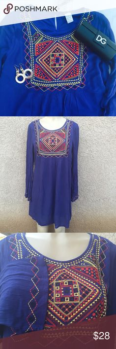 """🆕 Tunic top or dress Gorgeous embroidered tunic top . Could also be used at shirt dress . Material is 100% rayon with shell lining . Bust: 38"""" length :34. Tops Tunics"""