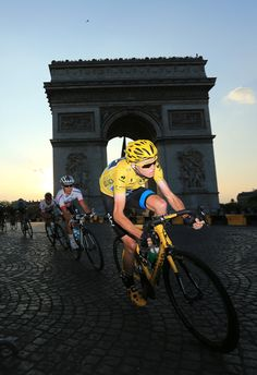 Winner of the 2013 Tour de France, Chris Froome drives the pace from the Arc d'Triomphe