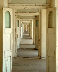 I adore this picture of doors opening onto a hallway of doors!