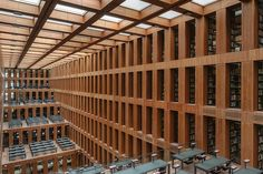 15 | 11 Of The World's Most Beautiful Libraries | Co.Design | business + design JACOB AND WILHELM GRIMM CENTRE, HUMBOLDT UNIVERSITY BERLIN The symmetry and the sparse use of materials create a peaceful atmosphere and a quiet sense of rhythm.