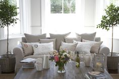 I like the balance of the plants on either side of the sofa Decor, Furniture, Shabby Chic, Home Living Room, Home Furnishings, Home N Decor, Home Deco, Shabby Chic Furniture, Home Styles