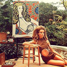 Verushka with portrait c. 1967.  Nice vinyl bubble over her stomach
