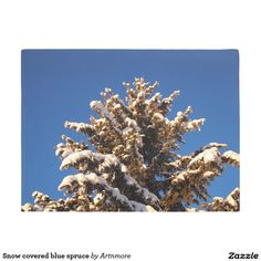 Snow covered blue spruce doormat