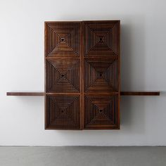 Custom-made wall-hung storage cabinet in jacaranda with lattice front, by Joaquim Tenreiro, Brazil, 1950s