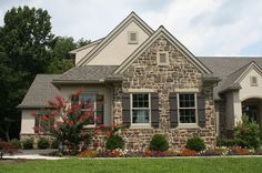 Custom home with stone veneer and board and batten shutters ...