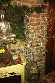 DIY Christmas decor: Spray painted branches with ornaments