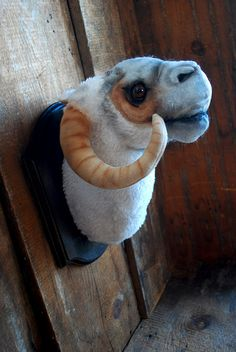 Plush Tauntaun head wall mount by Lana Crooks