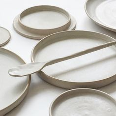 Minimal, clean white ceramic plates with clean lines, modern shaping, and a polished look. Cool stoneware table set. #Ceramic #Ceramics #CeramicDishes #Stoneware #CeramicPlates