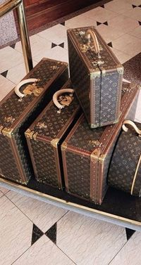 I ve always loved vintage Louis Vuitton luggage. There s something elegant  and romantic about it with all the travel stickers and they look worn and  faded. e6f48342a2