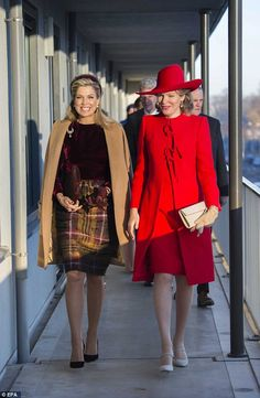 Máxima, left, went for a preppy look with a purple velvet long-sleeved top and a tartan sk...