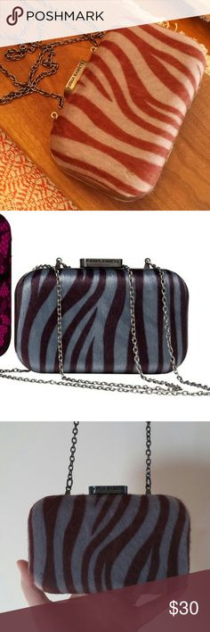 Kirna Zabete for Target zebra clutch NWOT rare! Gorgeous sassy zebra print clutch from the Kirna Zabete for Target collection!  Gray and maroon faux calf hair outer with a gray enamel snap closure and chain strap.  Strap and hardware are dark silver.  NEVER used! I took the tags off and then it sat on a shelf in my closet.  Get this amazing clutch for yourself today!  Strap measures 24 in from top of clutch. 4.5 in tall, 6.5 in wide, 2 in deep. Kirna Zabete Bags Clutches & Wristlets