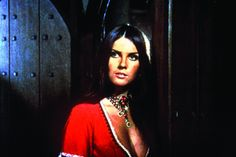 """Caroline Munro, Actress: The Spy Who Loved Me. Leggy, brunette-maned pin-up actress Caroline Munro was born in Windsor and lived in Rottingdean near Brighton where she attended a Catholic Convent School. By chance, her mother and a photographer entered her picture in a """"Face of the Year"""" competition for the British newspaper The Evening News and won. This led to modeling chores, her first job being for Vogue Magazine at age 17. She moved to ..."""