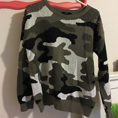 Camouflage sweater Like new camo sweater from Forever 21. Cool stud detailing on the shoulders. Only worn once. Soft and warm! Size large, bought to be oversized. But it's really not that big! Forever 21 Sweaters Crew & Scoop Necks