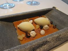 Maple syrup cream with pear and cardamom ice cream, Guinness jelly, pear bonbons and hazelnuts, at El Celler de Can Roca.