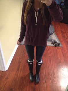 Brandy mellville hoodie and hunter boots.