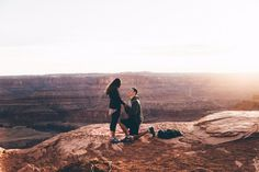 He asked her to marry him at Arches National Park, 2,000 feet above the canyon! It doesn't get much better than this sunset proposal.