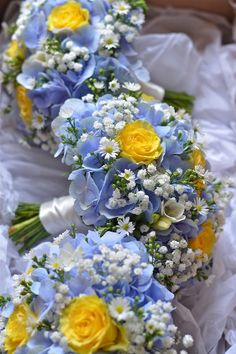 blue and yellow flowers for wedding | Bridesmaids bouquets in blue and yellow, all boxed and ready to go. A ...