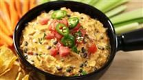 This is a scrumptious taco dip. When I use all low-fat ingredients, such as low-fat sour cream and low-fat Cheddar, it still comes out so delicious! Serve with baked tortilla chips for dipping.