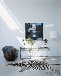 Alexandra de Garidel-Thoron - Philippe Berry console, Christian Liaigre's Amande lamp, Marina Abramovic photograph, cement floors, Barry Flanagan abstract rabbits sculptures, Carmen Perrin sculpture