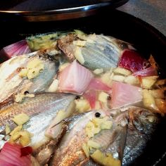 """Paksiw na Isda -A Filipino dish, fish cooked in vinegar with water, garlic, ginger and onions, serve with rice. Take note: you don't eat the eyeball and skin. Lol"""