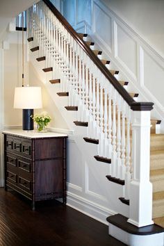 Plandome Dutch Colonial- Idea to open up foyer and dining room and see on to kitchen by removing the wall between stairs and dining room (use simpler spindles though). The wainscoting up the stairs could be repeated in dining room. Stairway Decorating, Foyer Decorating, Decorating Ideas, Decor Ideas, Wood Stairs, Stair Railing, Banisters, Railing Ideas, Black Banister